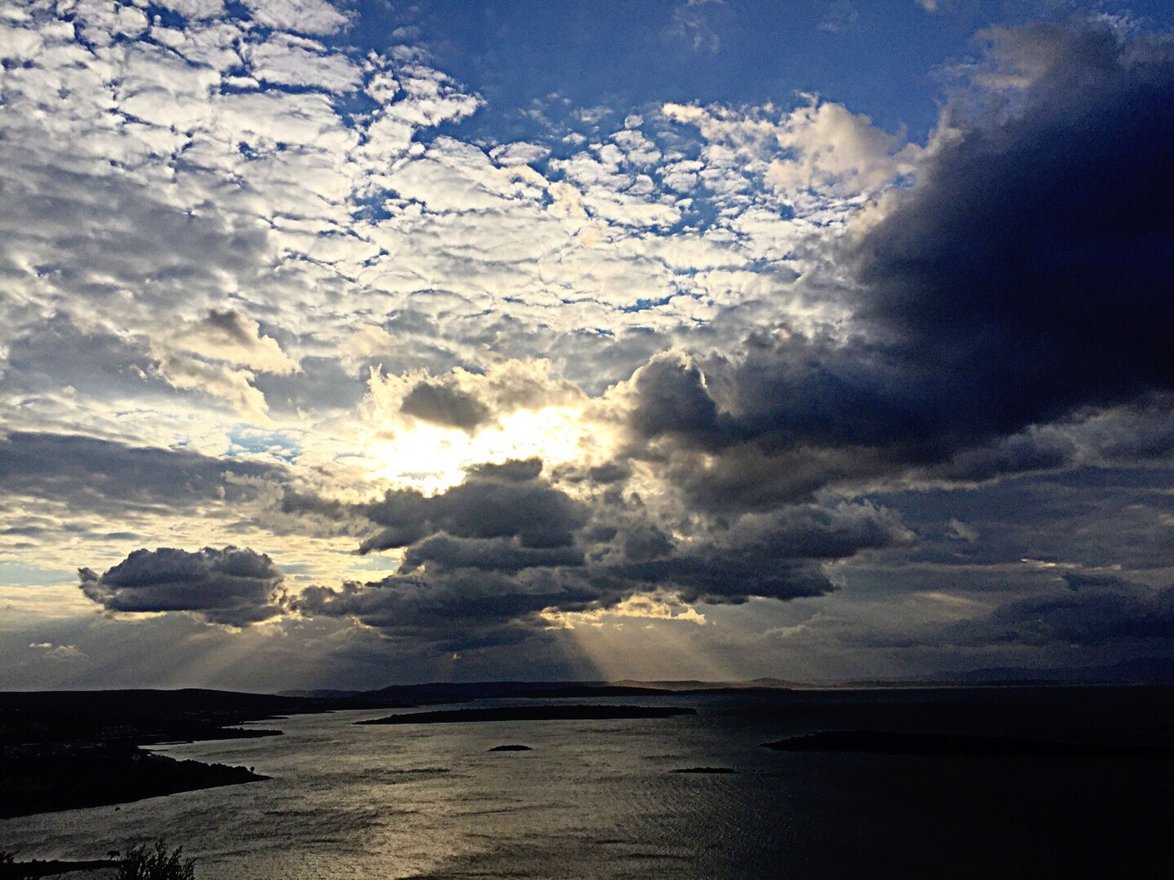 water, tranquil scene, scenics, sea, tranquility, beauty in nature, waterfront, nature, calm, sky, cloud - sky, cloudy, cloud, idyllic, seascape, ocean, outdoors, day, non-urban scene, cloudscape, remote, coastline, majestic, dramatic sky, atmospheric mood, no people, shore, cumulus cloud