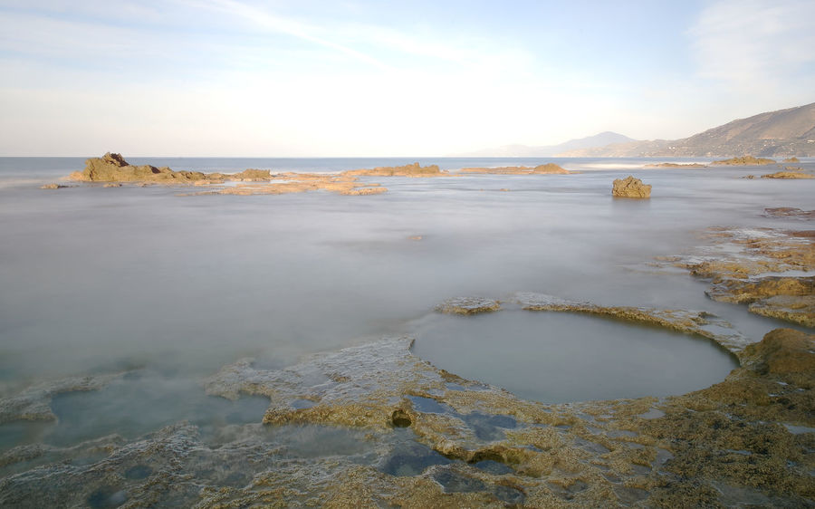 cliff of the salt marshes in the locality of Palinuro in the Cilento National Park Motion Blur Beauty In Nature Circle Shapes Day Landscape Motion Blurred Mountain Nature No People Outdoors Rock - Object Scenics Sea Sky Sunrise Tranquil Scene Tranquility Water