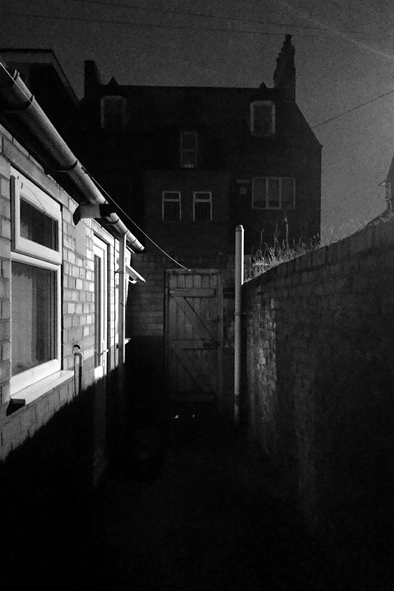 10:07pm Building Exterior Outdoors Architecture Night Moody Urban Shadow Low Angle View The City Light Social Issues Industry Grit Wide Angle Streetlight Streetphoto_bw Blackandwhite