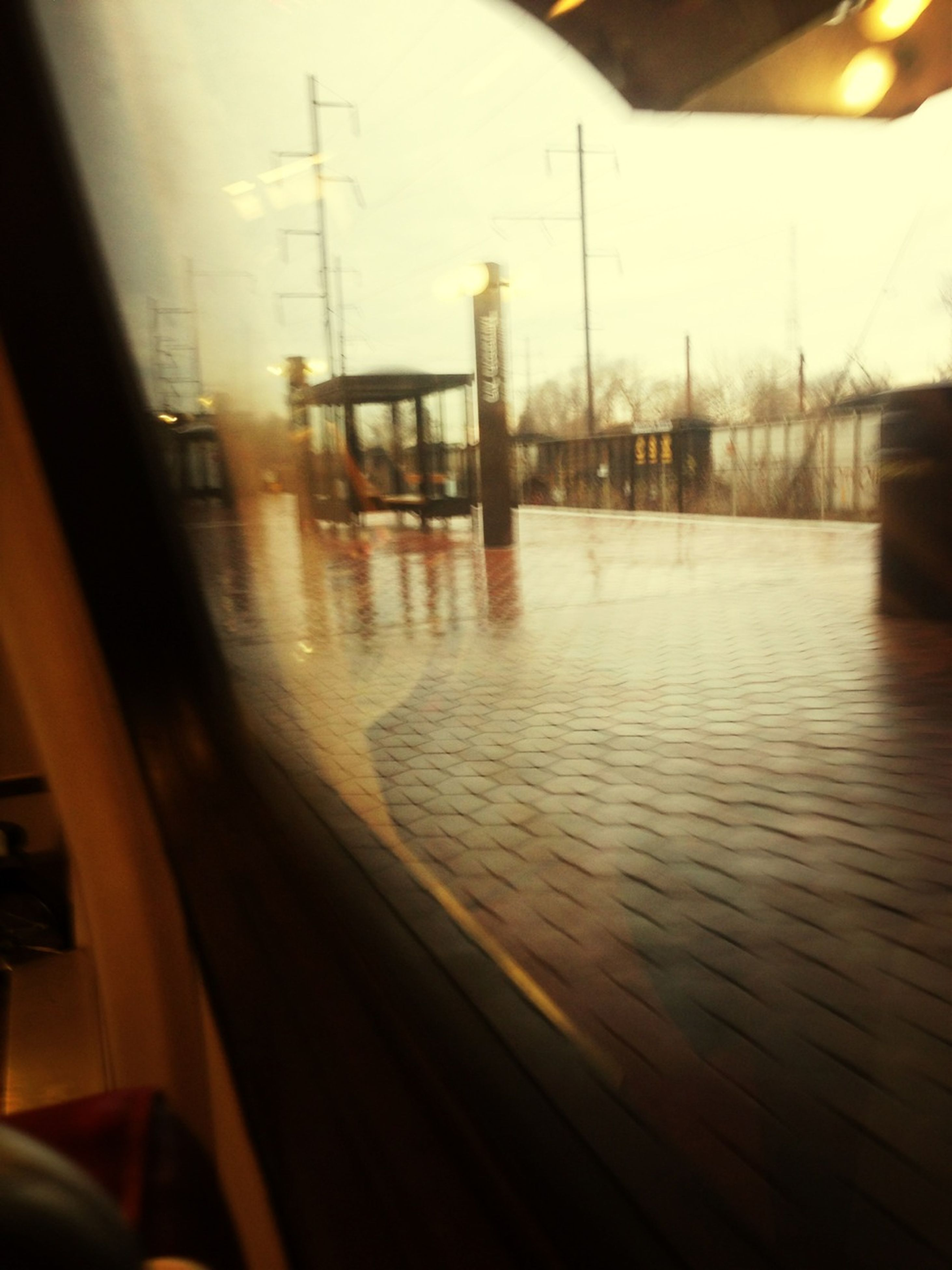 transportation, indoors, window, mode of transport, transparent, glass - material, vehicle interior, car, land vehicle, reflection, illuminated, travel, public transportation, empty, no people, built structure, train - vehicle, street, looking through window, windshield