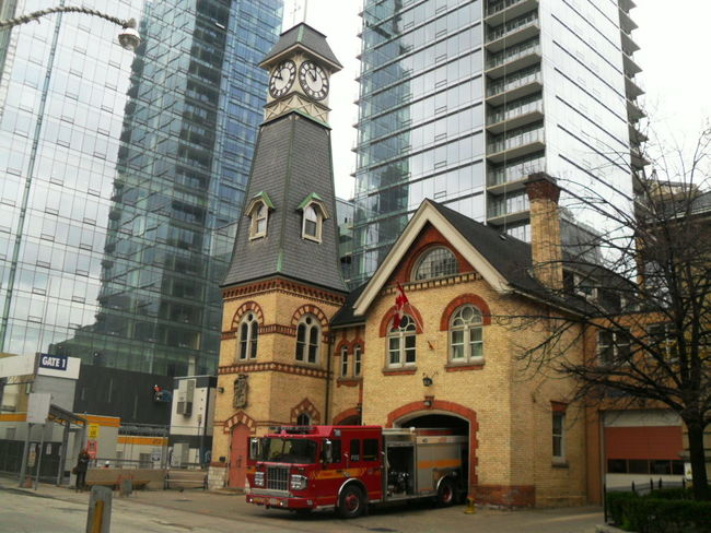Architecture Building Exterior Built Structure City Day Downtown District Fire Fire Station Fireman Greatness No People Outdoors Skyscraper Travel Destinations Yellow Taxi