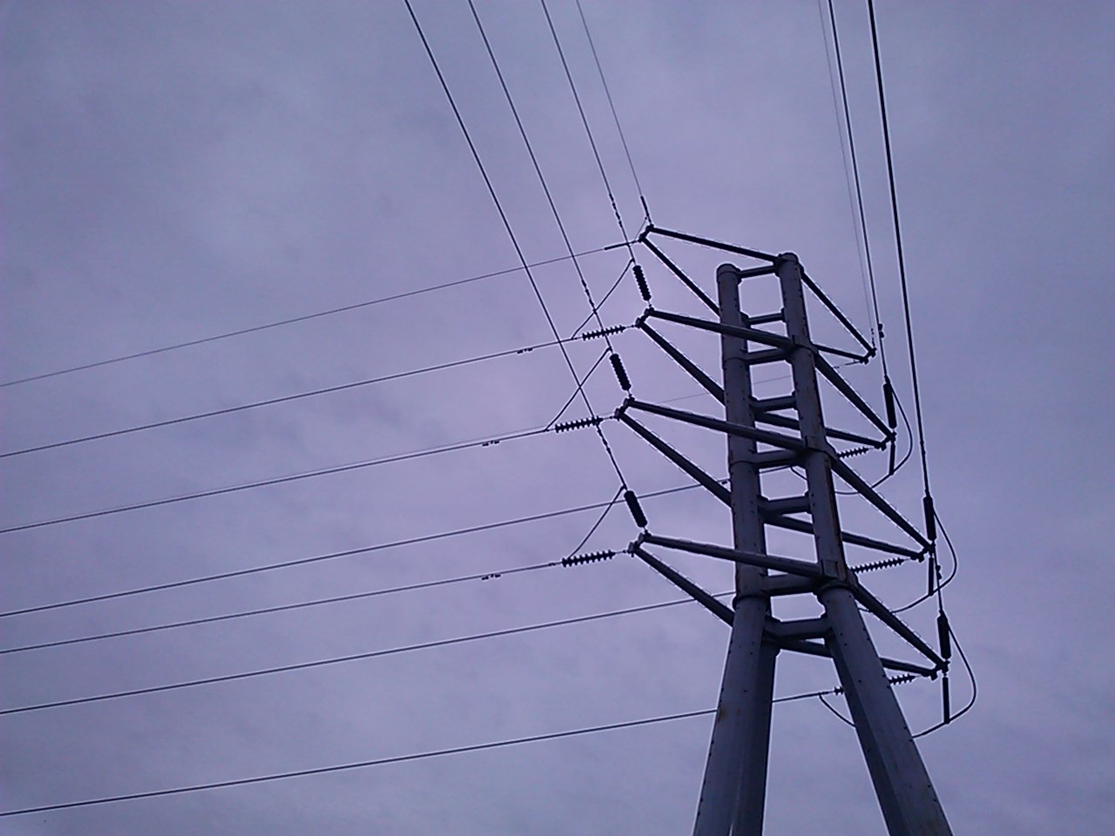 low angle view, power line, electricity pylon, power supply, electricity, connection, fuel and power generation, technology, cable, sky, silhouette, power cable, outdoors, no people, complexity, day, cloud, blue, cloud - sky, nature