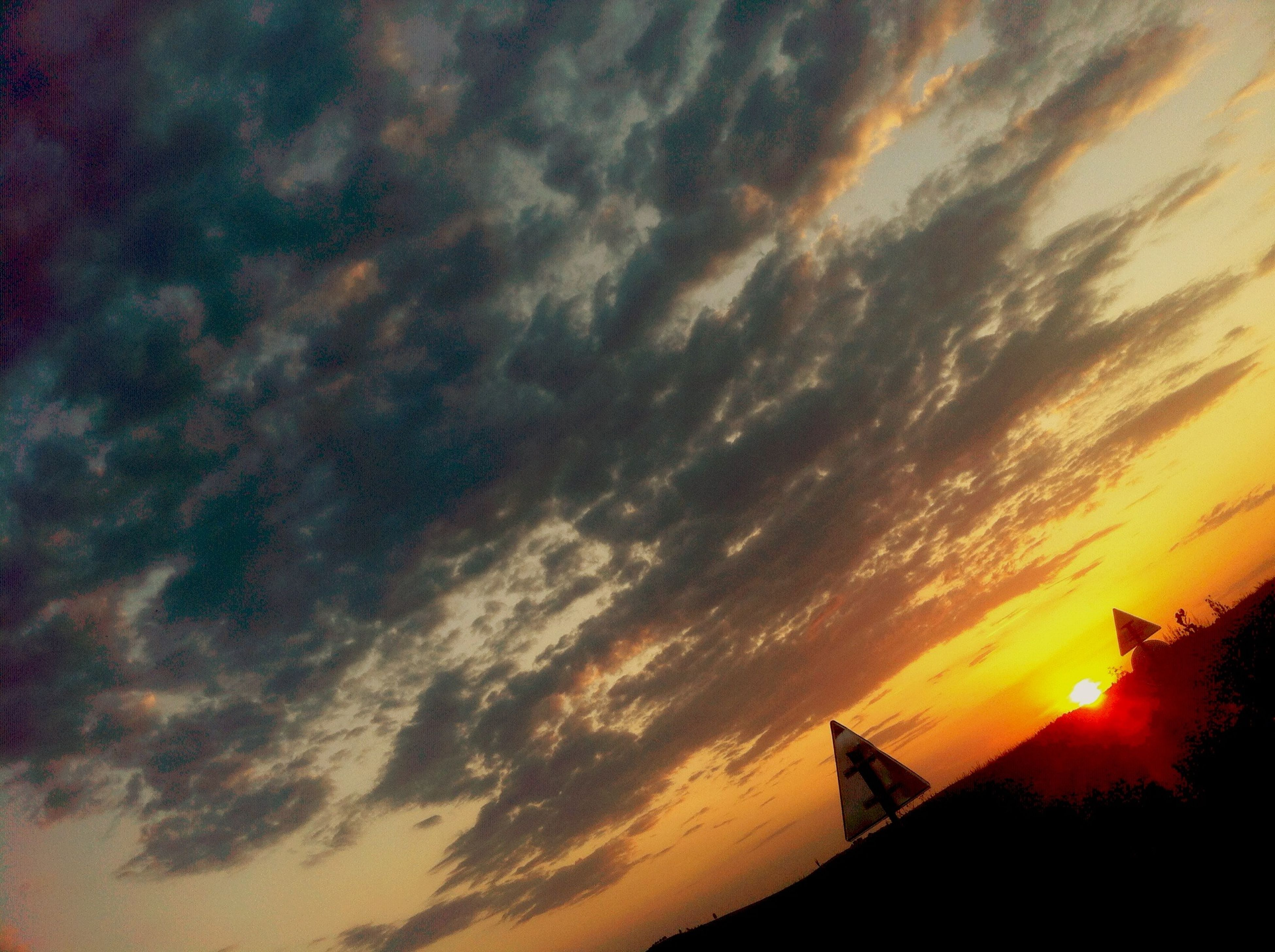 sunset, sky, architecture, silhouette, building exterior, built structure, cloud - sky, low angle view, orange color, cloudy, cloud, scenics, beauty in nature, dramatic sky, nature, outdoors, high section, tranquility, house, no people