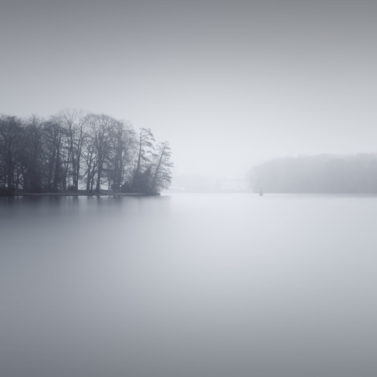 scenic view of lake against sky during winter Bare Tree Beauty In Nature Cold Temperature Day Fine Art Fog Lake Landscape Long Exposure Muted Colors Nature No People Outdoors Philipp Dase Reflection Scenics Sky Snow Tranquil Scene Tranquility Tree Water Weather Winter