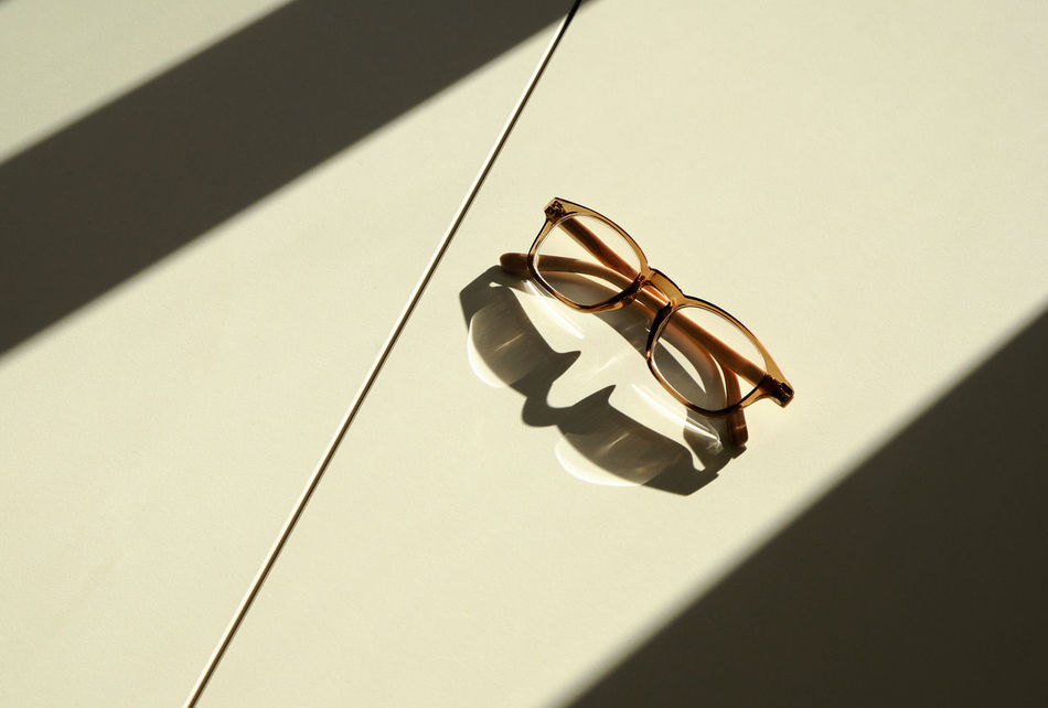 Back Light Copy Space Day High Angle View High Contrast Indoors  Left Behind Lines And Shapes Low Angle View Minimal No People Reading Glasses Reflection Of Reading Glasses Simplicity Sun Through Window Sunbeam Sunlight Tranquil Scene White Table