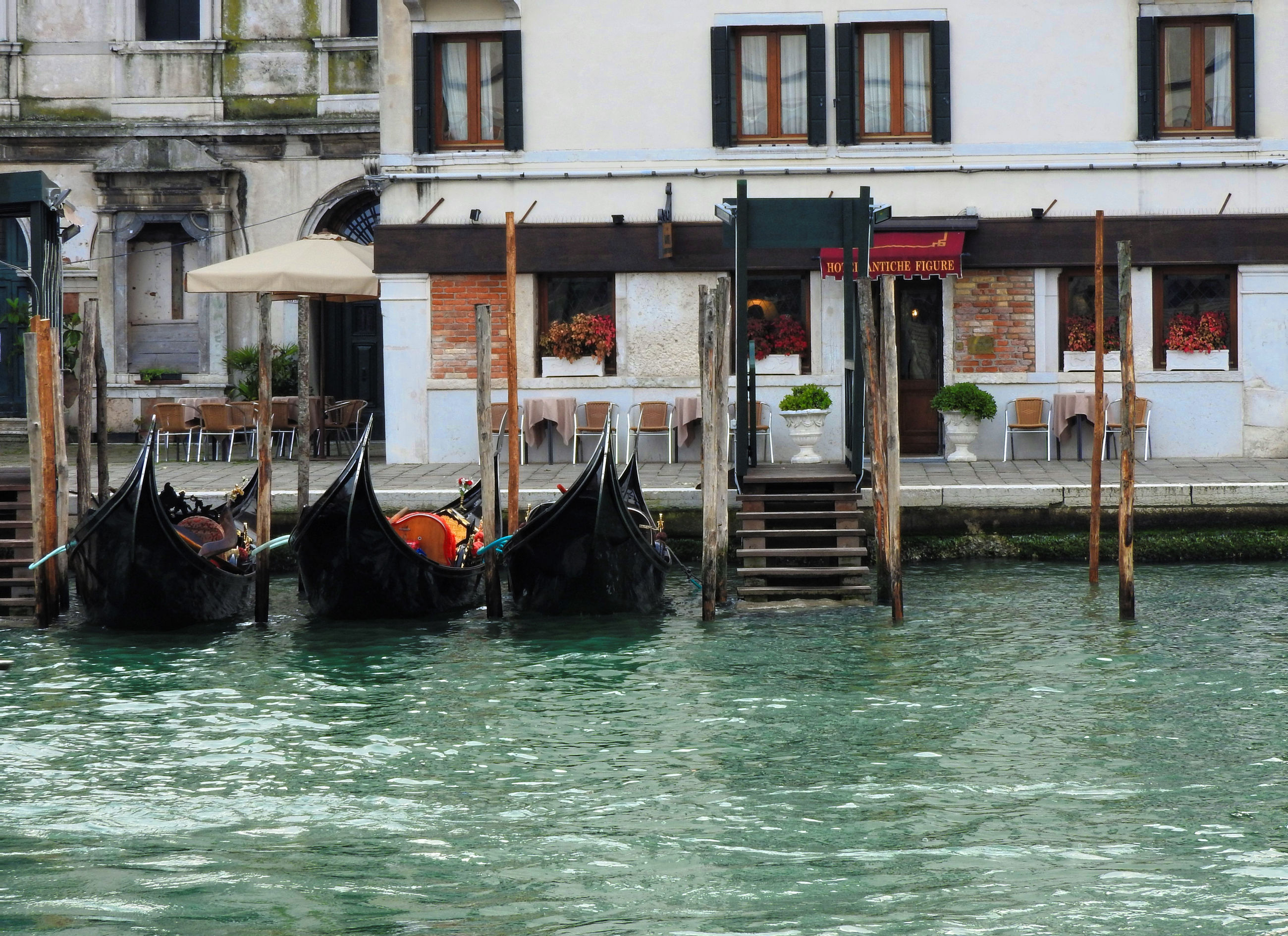 cultures, gondola - traditional boat, travel destinations, canal, tourism, gondolier, travel, building exterior, nautical vessel, vacations, water, transportation, outdoors, people, architecture, day