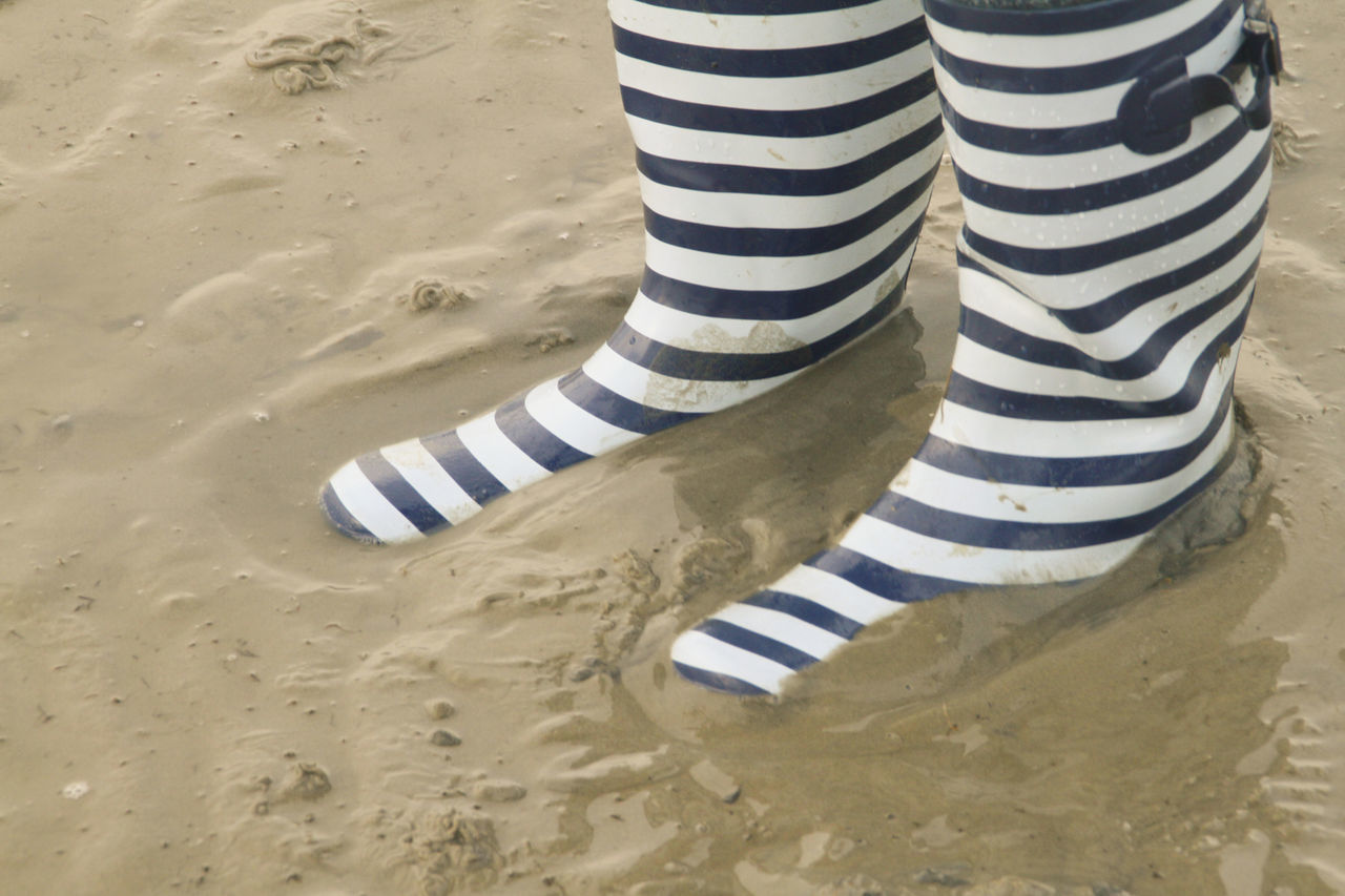 Rubber Boots Wadden Sea Beach Casual Clothing Day Human Body Part Human Leg Leisure Activity Low Section Nature One Person One Woman Only Outdoors Pattern People Rubber Boots Sand Striped Vacations Wadden Sea Waddensea Women