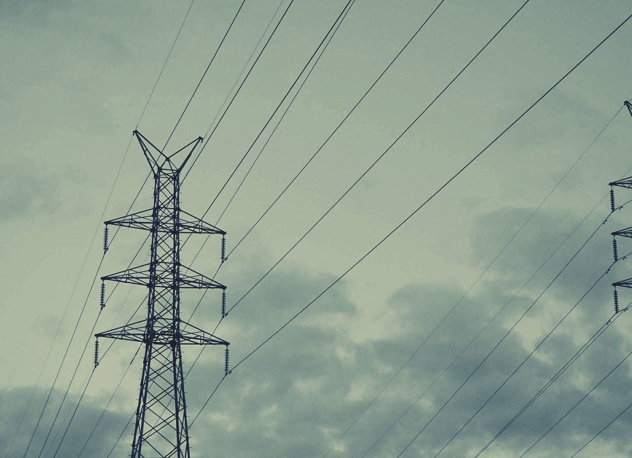 Electricity  Electricity Pylon Connection Sky No People Power Supply Power Line  Cable Technology Cloud - Sky Day Outdoors Low Angle View Geometric Symmetry