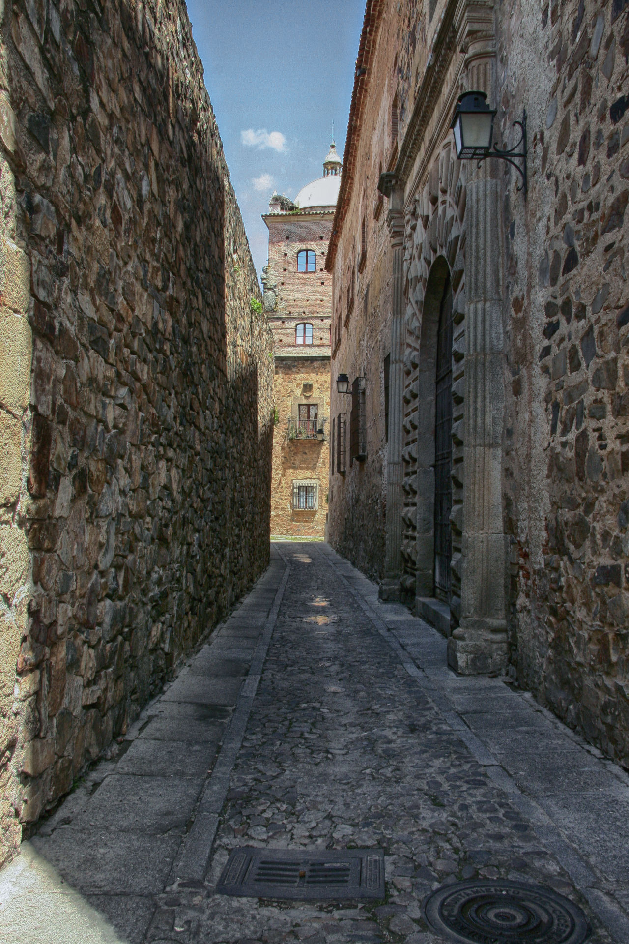empty; nobody; antique; architecture; building; caceres; center; city; extremadura; heritage; historic; landmark; medieval; outdoor; patrimony; quarter; spain; stone; street; touristic; travel; urban Architecture Building Exterior Built Structure Day No People Outdoors Sky The Way Forward