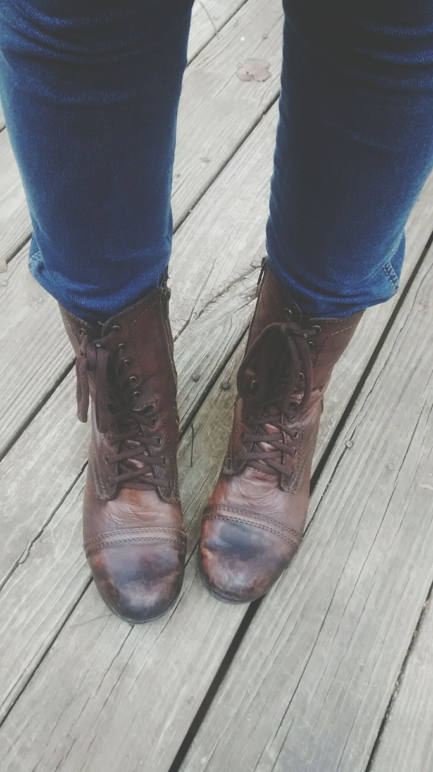 wood - material, wooden, shoe, plank, wood, low section, high angle view, close-up, boardwalk, footwear, person, table, hardwood floor, metal, part of, still life, pair, brown, outdoors, day