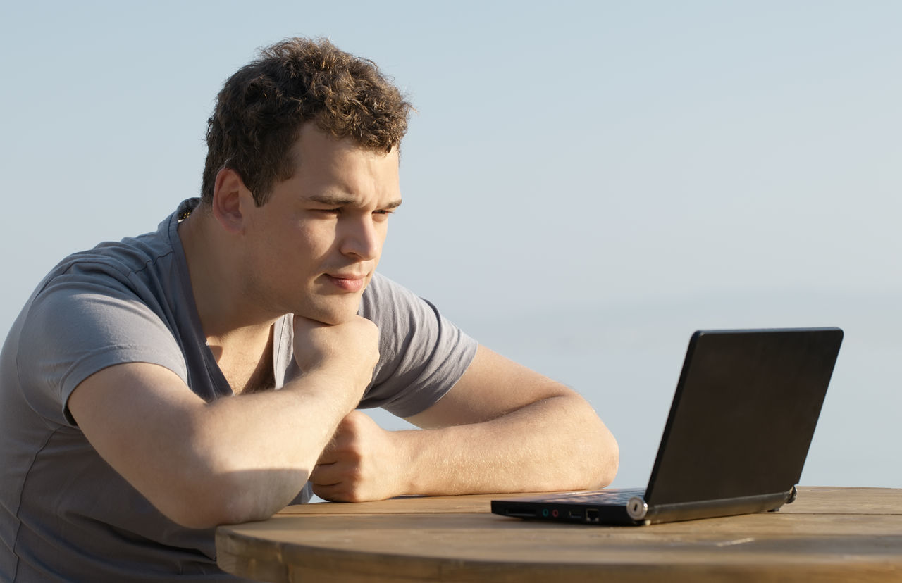 Beach Business Businessman Caucasian Communication Computer Handsome Human Hand Internet Laptop Man Manager Notebook People Person Real People Sea Table Technology Typing