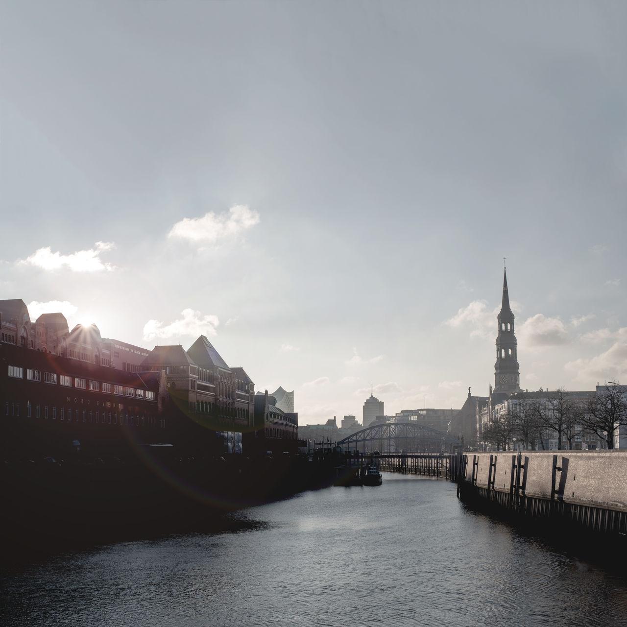 Channel Cityscape Clouds First Eyeem Photo Fleet Hamburg Landmark River Scenics Speicherstadt Sunlight Urban Warehouse District Water