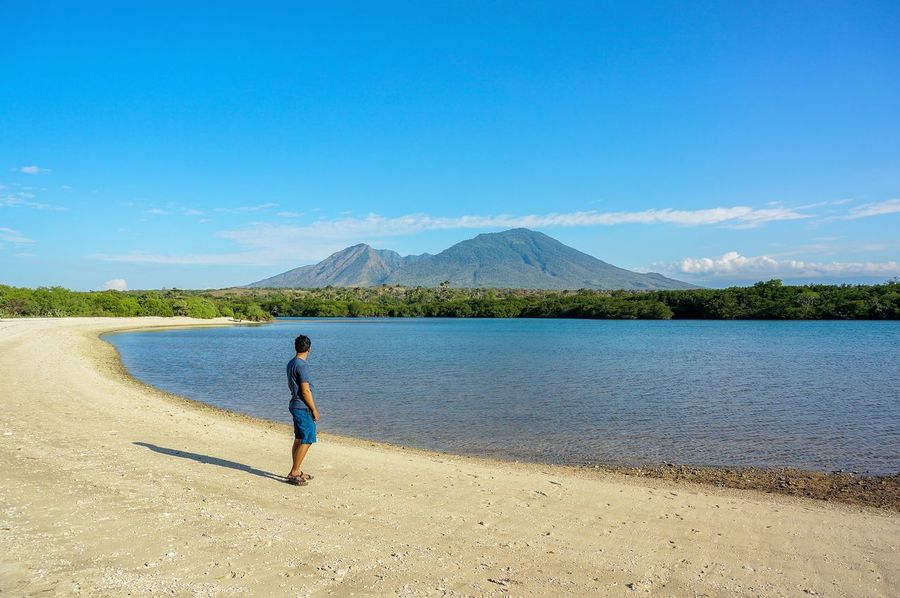 Rear View One Person One Man Only Only Men Lake Water Mountain People Day Blue Sky Men Outdoors Nature Beauty In Nature Beach Beach Holiday Beach Life Beachview Baluran Balurannationalpark Lost In The Landscape Connected By Travel