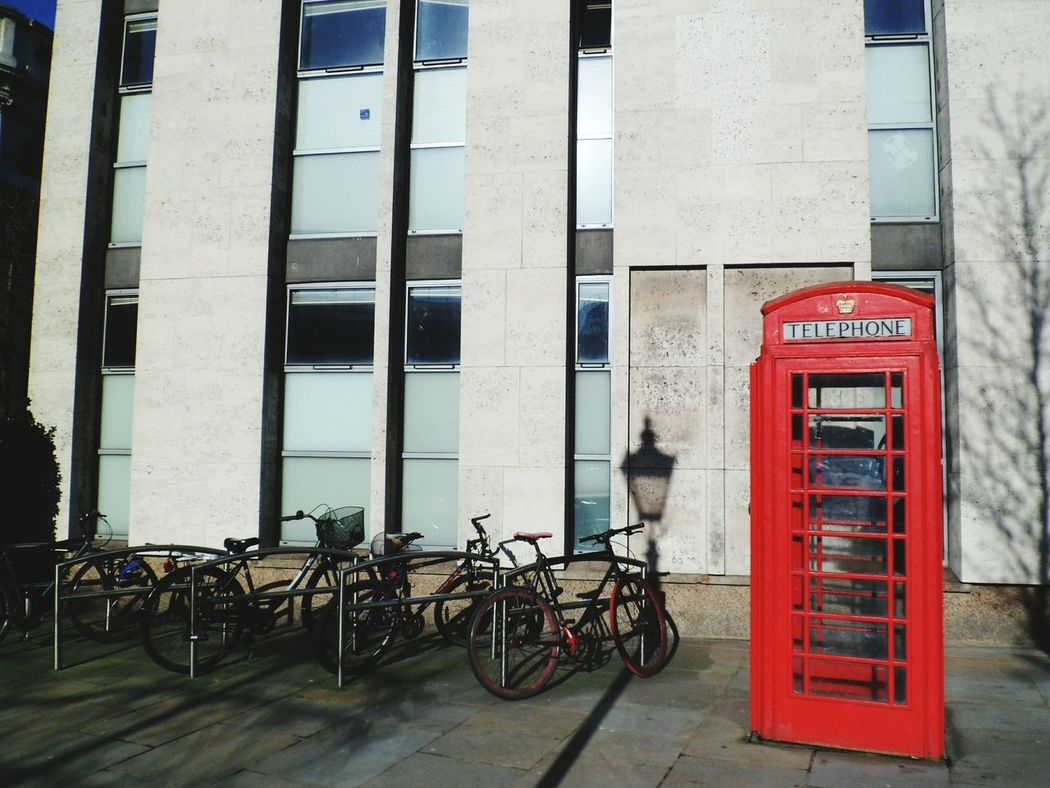 And back to London! Day Outdoors Streetphotography Street No People Telephone Bycycle Bike Phone Box Phone Booth Building Building Exterior Transportation Shadow Phone 2016 Architecture Photography Pavement Travel Destinations Tourism Communication Telephone Box Connection Travel