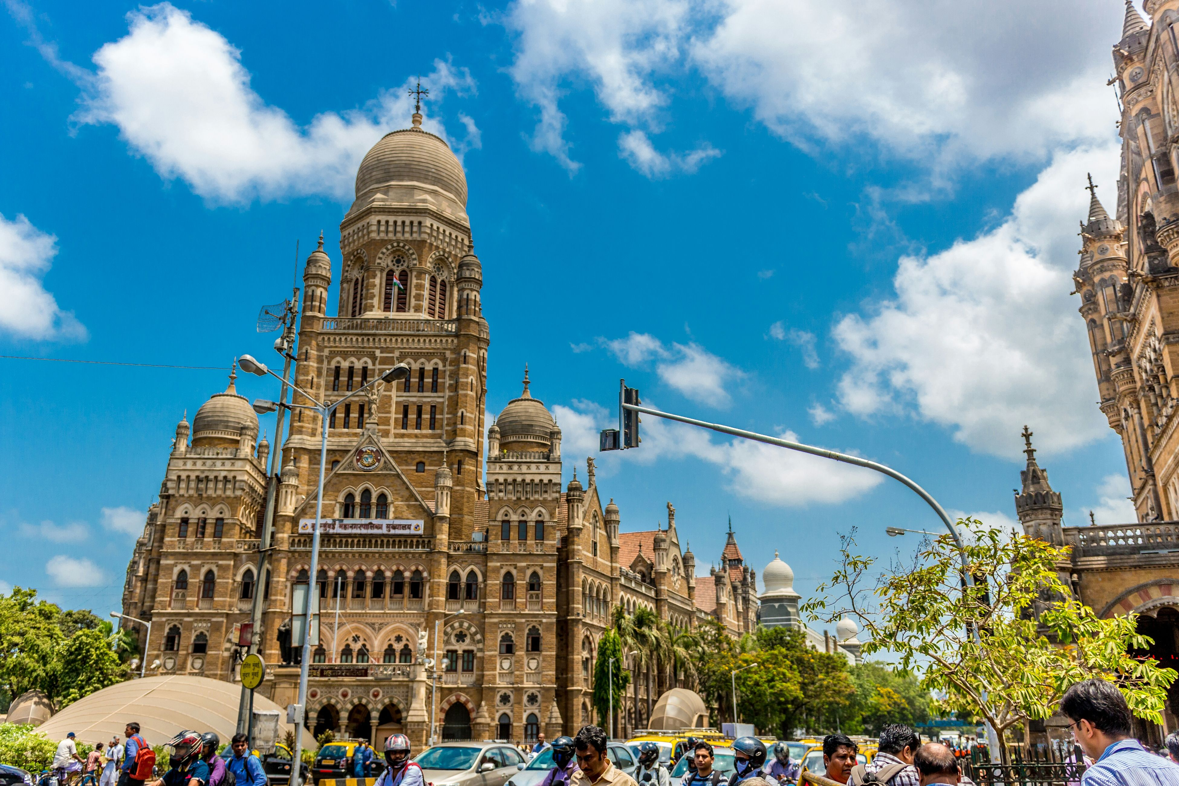 architecture, building exterior, built structure, famous place, sky, large group of people, tourism, place of worship, travel destinations, religion, history, travel, tower, church, spirituality, person, international landmark, tourist