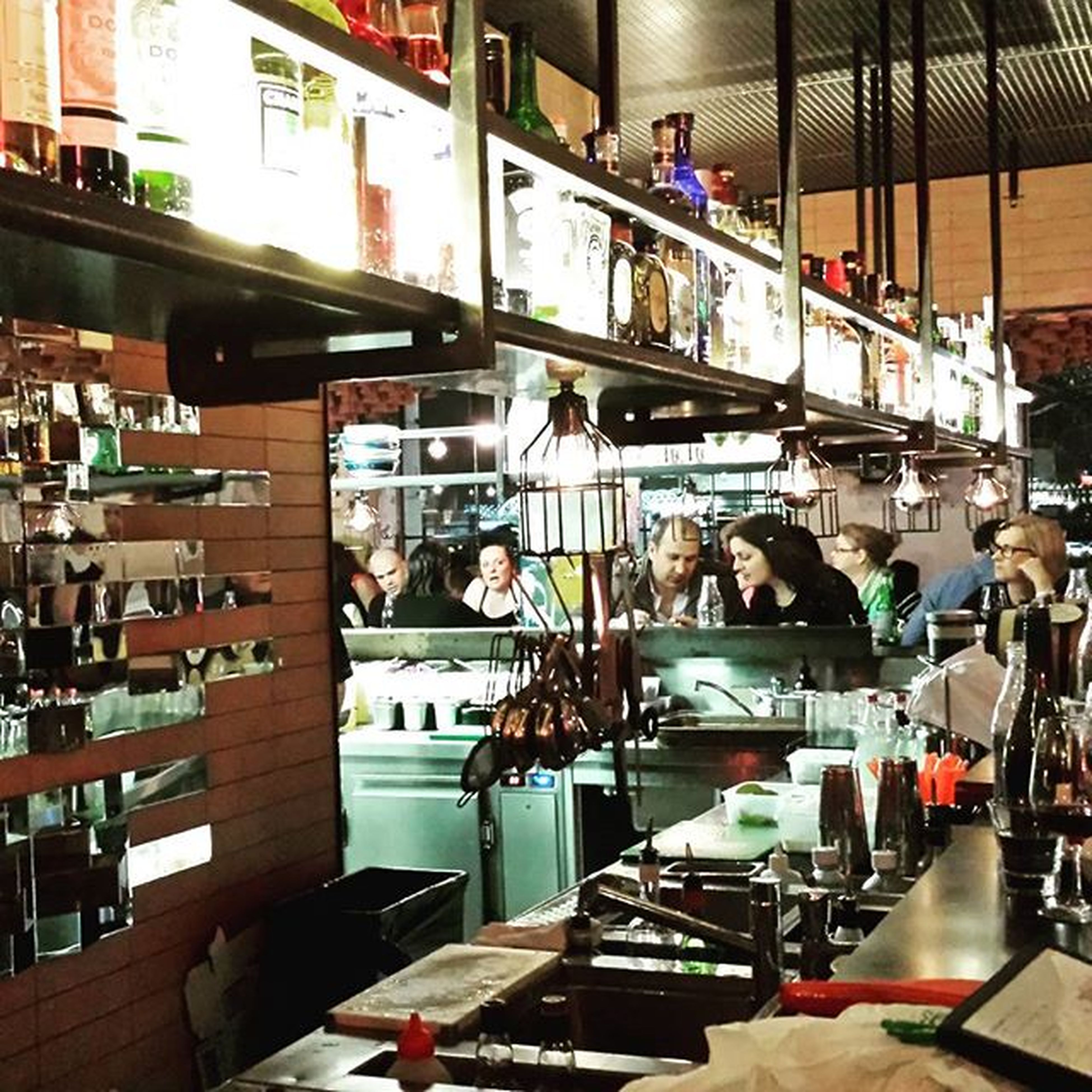 indoors, men, retail, person, arrangement, table, variation, high angle view, large group of objects, lifestyles, choice, store, restaurant, shopping, food and drink, sitting, incidental people, small business, for sale