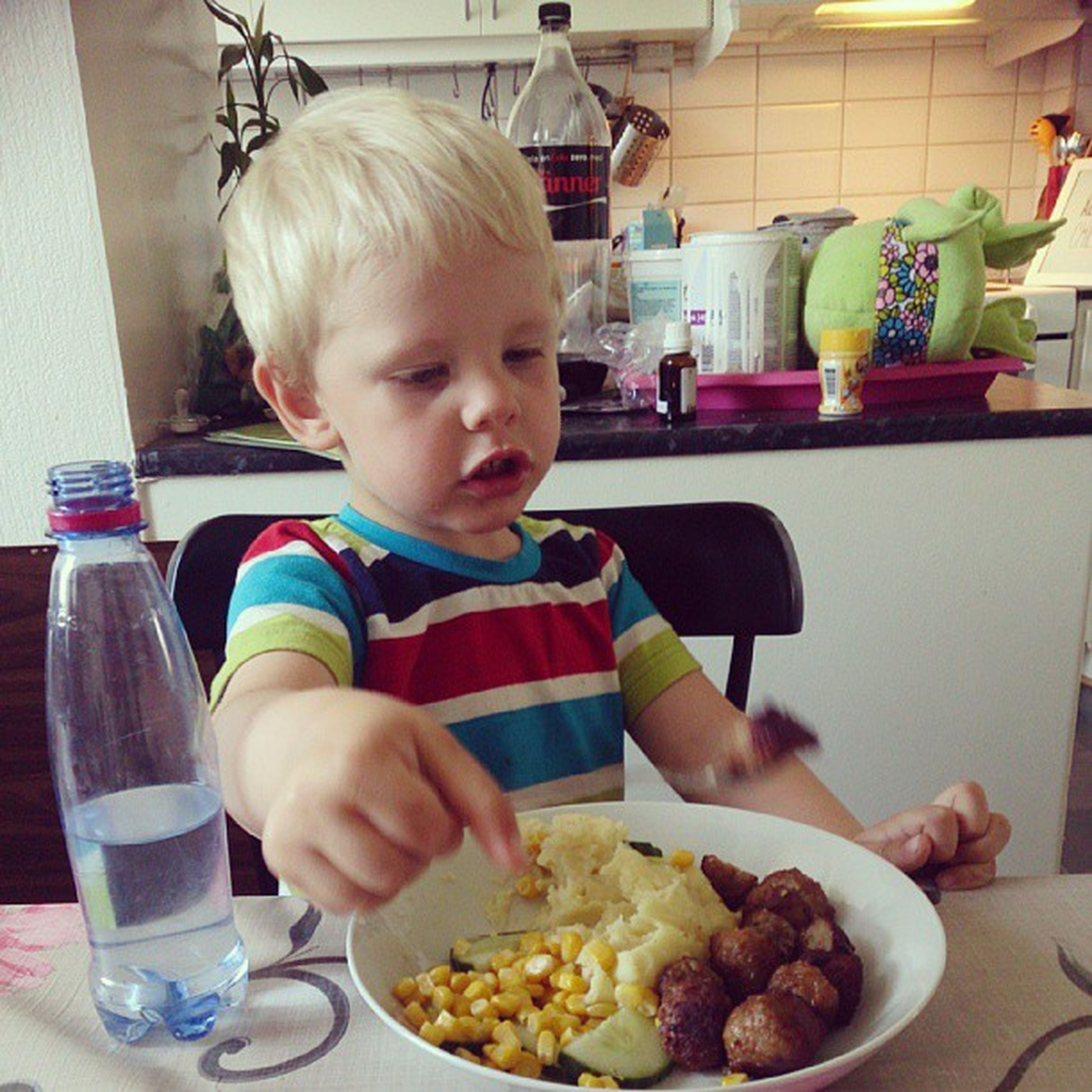 food and drink, indoors, food, freshness, childhood, holding, sweet food, elementary age, indulgence, eating, ready-to-eat, boys, lifestyles, cute, unhealthy eating, person, leisure activity, drink