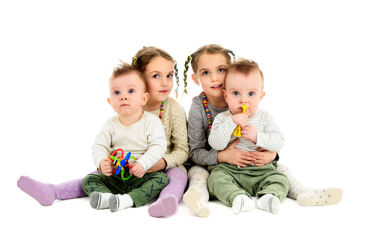 Having twins twice. Two pairs, sets of twin baby and twin children. Identical twin sisters are hugging identical twin brothers. Baby Double Exposure Four Twins Happiness Hug Identical  IDENTICAL TWINS Looking At Camera People Portrait Sitting Studio Shot Togetherness Twin Brother Twin Sisters Twins Two People White Background