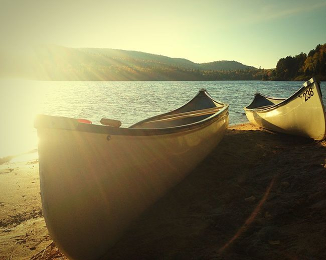 Escape from city life. Camping Canoes Mountains Lake