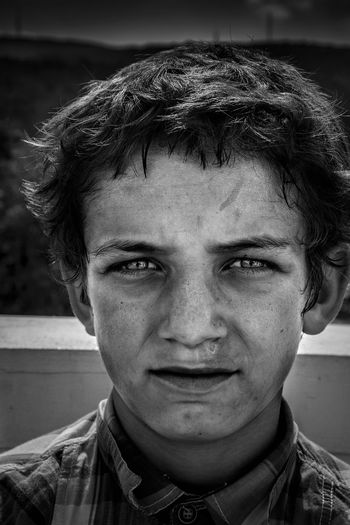 Portrait Headshot Human Face Close-up Day Outdoors Serious Eyes Street Photography Check This Out The Week On EyeEm Streetphotography Black And White Photography Monochrome Blackandwhite Fujifilm Real People People Photo Travel Boy Looking Childhood Black & White Friday