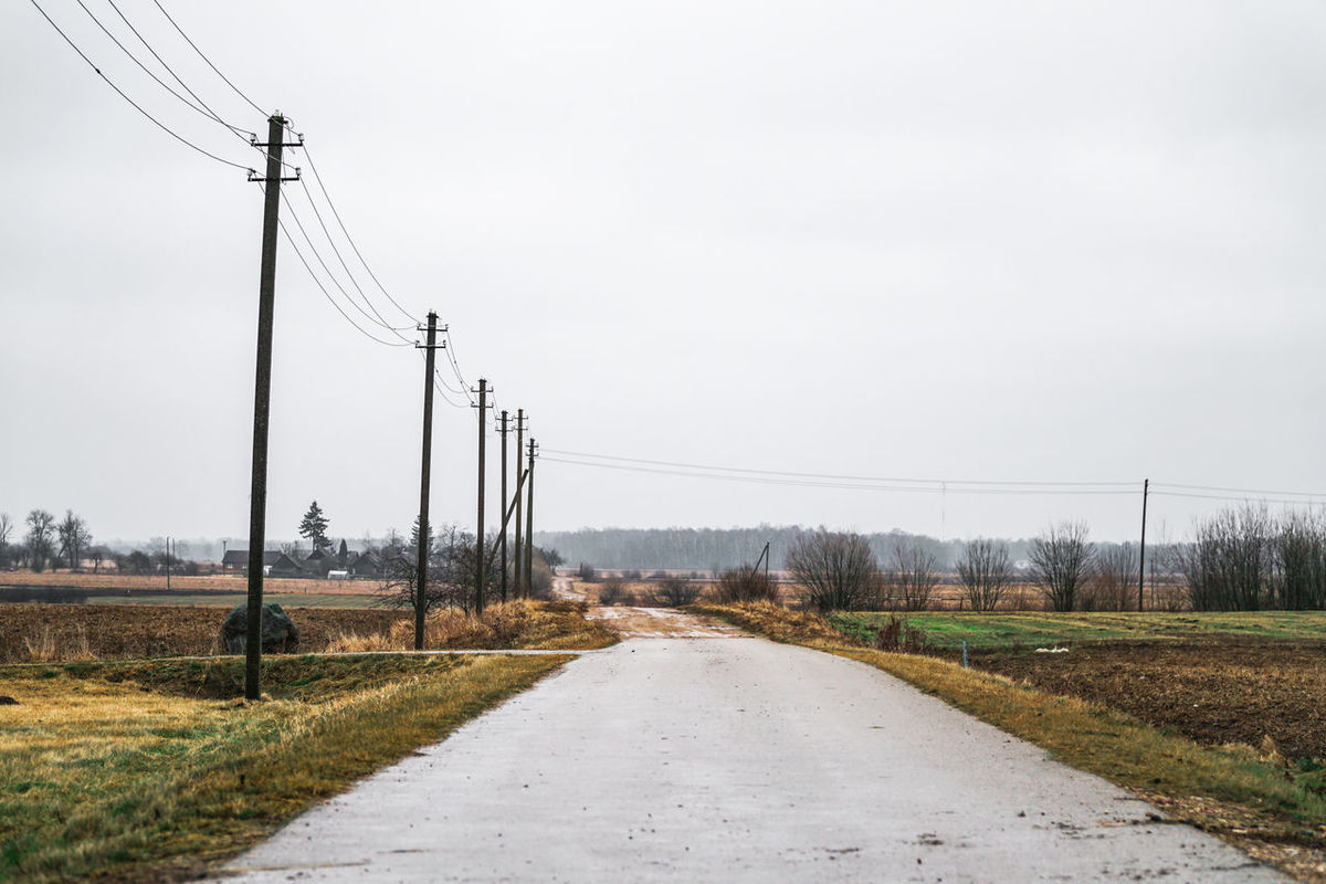 The end of the tarmac road - rural agricultural landscape in eastern europe After Winter Agriculture Before Summer  Belarus Cable Countryside Eastern Europe Electricity  Electricity Pylon End Landscape Latvia Lithuania Nature Poland Power Line  Power Supply Road Rural Rustic Tarmac Transportation Village Wake Up Wet