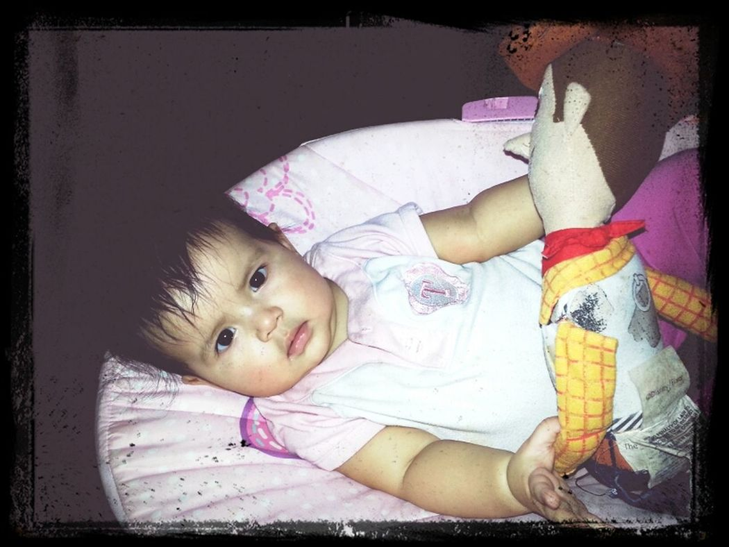 my baby playing with woody...lol