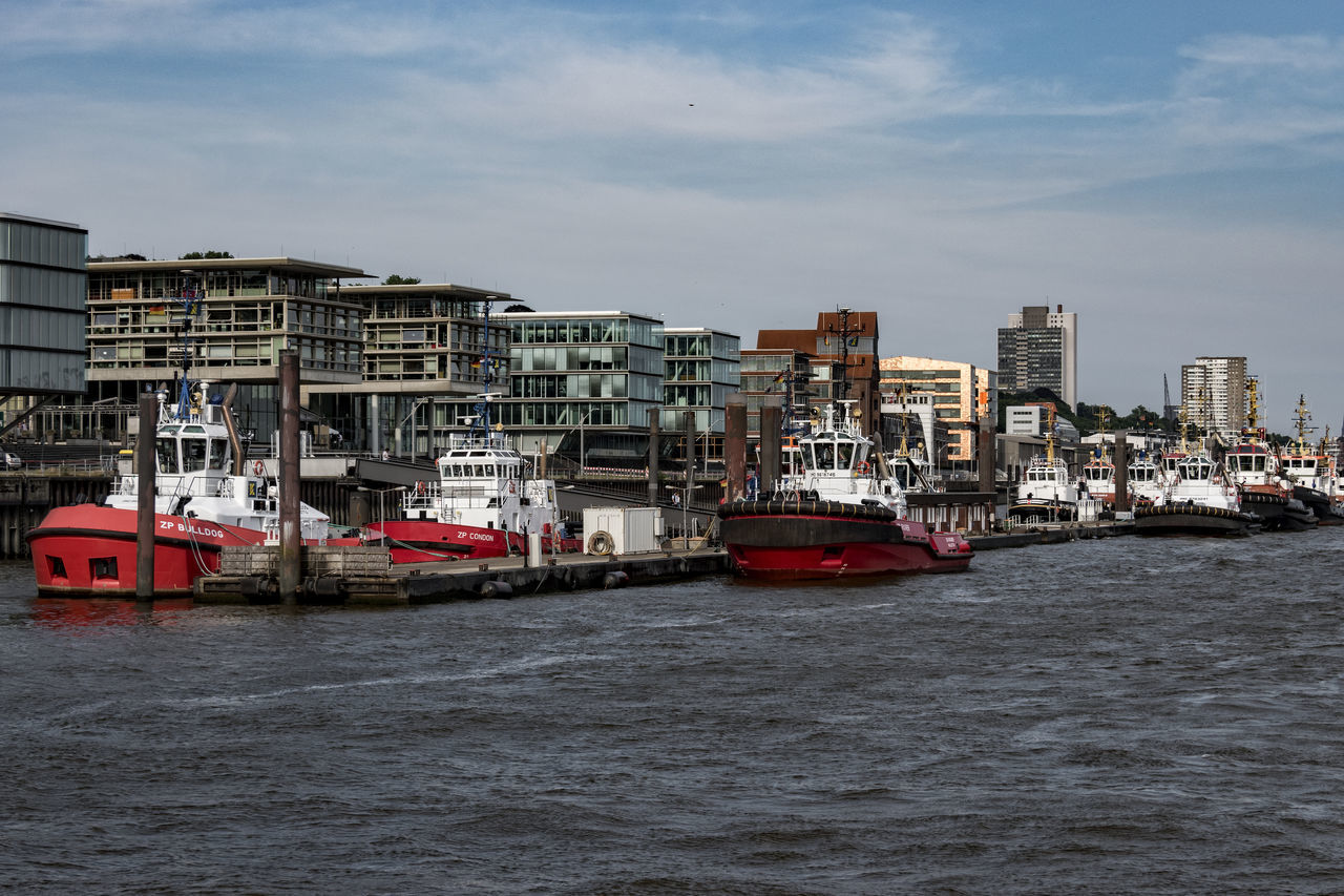 Bugsierer Architecture Bugsierer Building Exterior Built Structure City Cityscape Day Elbe River Hamburg Harbour Mode Of Transport Nature Nautical Vessel No People Outdoors River Sky Transportation Water Waterfront