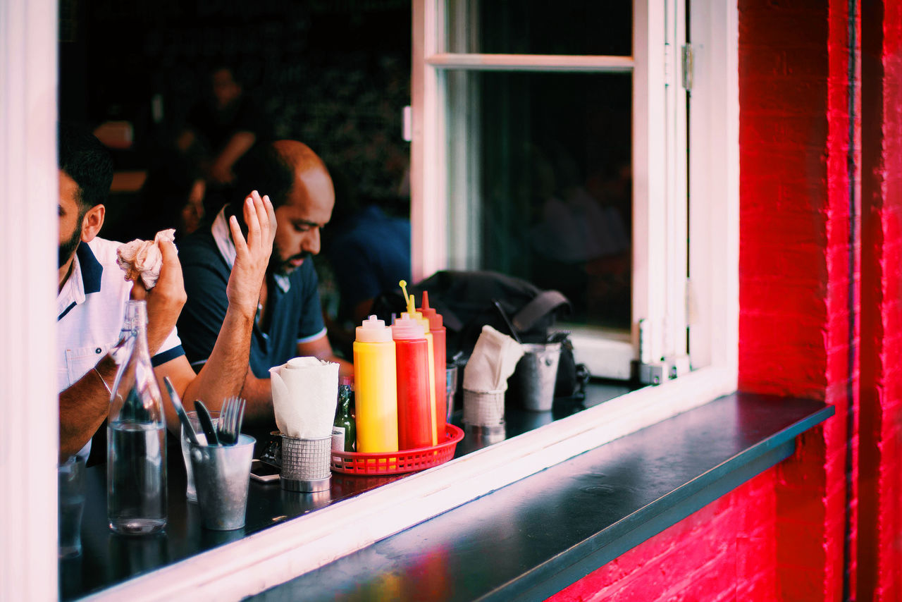 Day Dining Out Eating Out Experssions Food Food And Drink Friends Eating And Drinking Gesture Hand Hands Human Hand Indoors  Ketchup Lunch Lunchtime Meal Meal Out Mealtime Men People Real People Restaurant Sauce Summer Food Young Adult The Street Photographer - 2017 EyeEm Awards