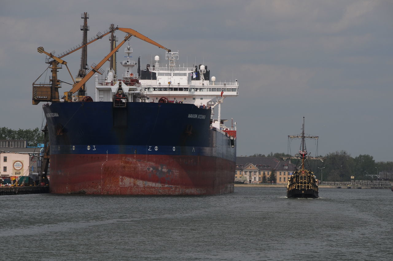 relations Business Commercial Dock Container Ship Crane - Construction Machinery Day Floating On Water Freight Transportation Gasoline Gdansk Gdansk Harbor Harbor Industry Mode Of Transport Nautical Vessel Outdoors Relationship Sailing Sea Ship Shipping  Transportation Water