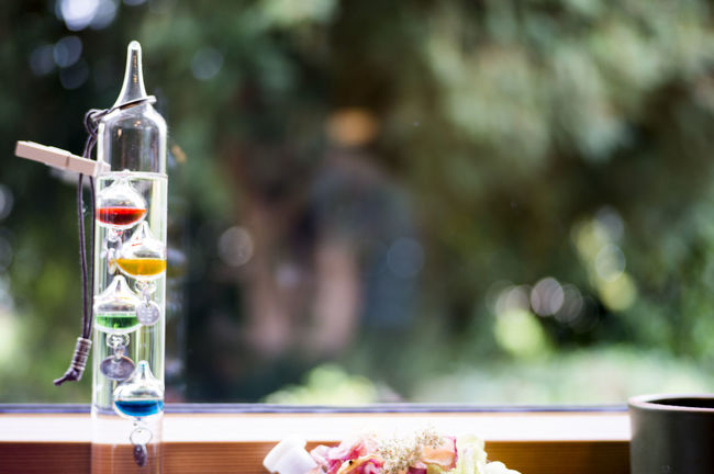 Bokeh Bokeh Photography Bokehlicious Focus On Foreground Galileo Thermometer Based On The Physics Principle That The Density Of A Liquid Is Related To Its Temperature Galileo Thermometers Thermometer Window