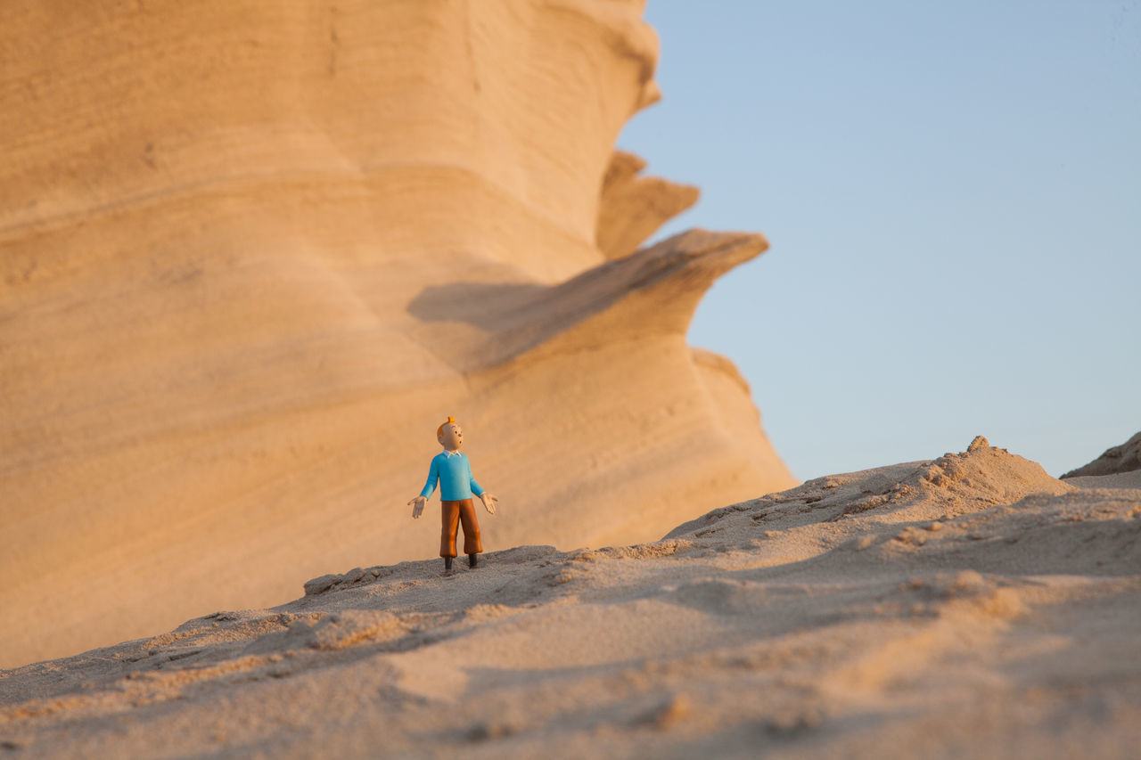 Arid Climate Beach Beauty In Nature Childhood Clear Sky Day Desert Doll Full Length Geology Nature Outdoors People Rear View Rock - Object Rock Formation Sand Sand Dune Scenics Sky Sunlight Tintin Walking