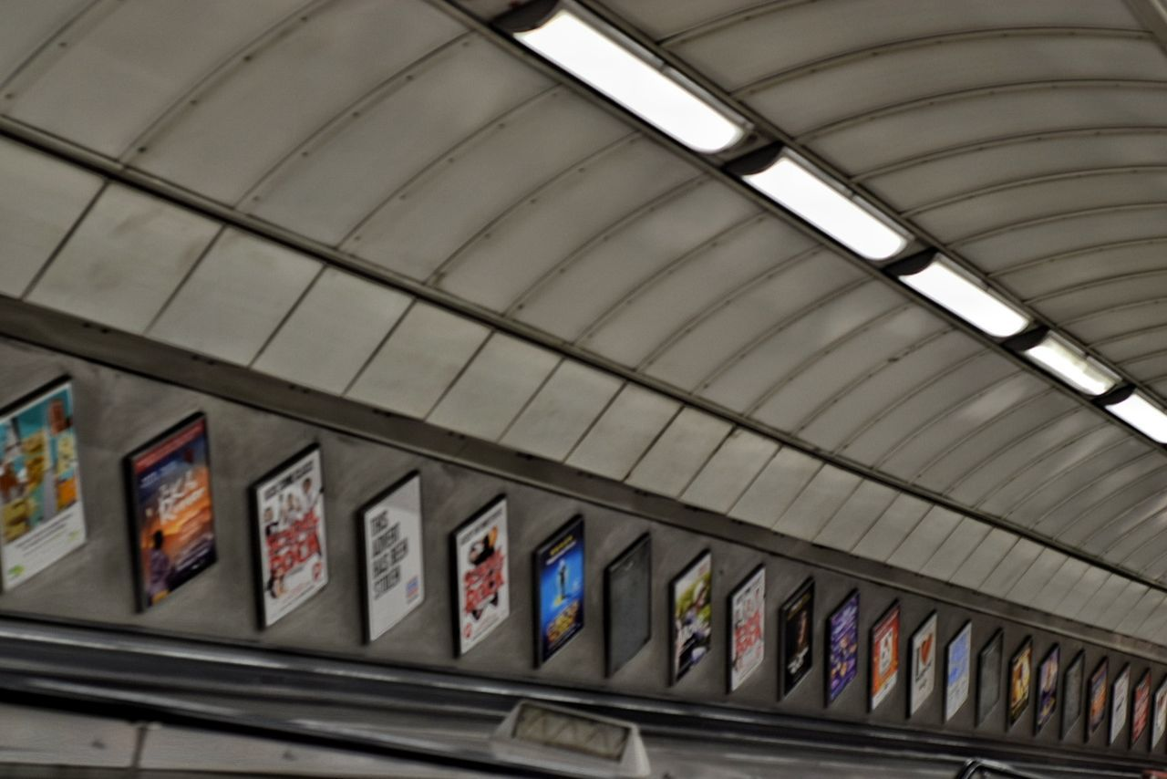 London Underground Indoors  No People Modern Architecture Posters Lighting Lines Perspective Tube Station  Squares Angles And Lines Angle Photography Shapes Shapes And Lines Looking Down Advertising Backgrounds Curves City Going Down Uniformity Strip Lighting