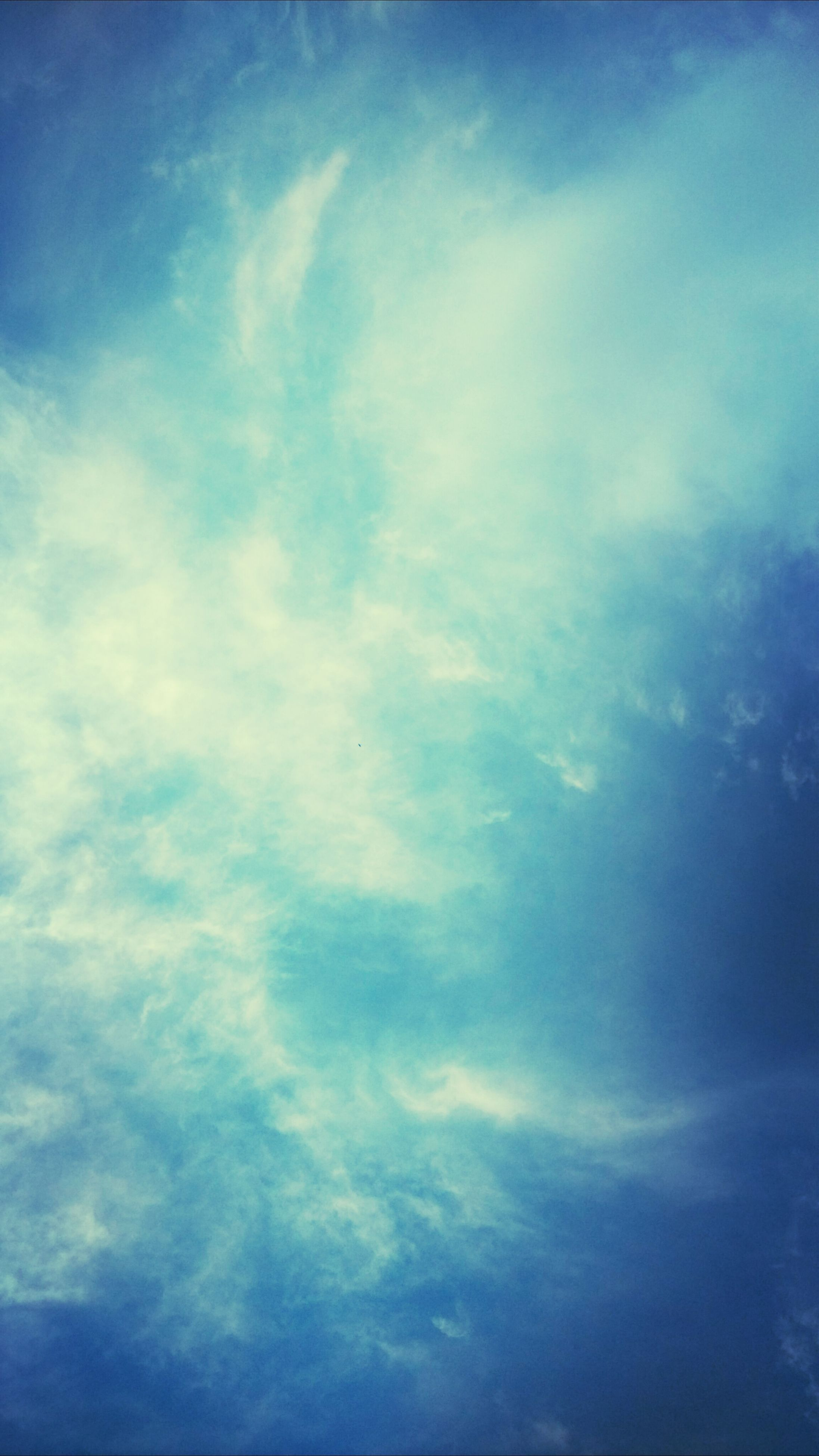 sky, low angle view, blue, cloud - sky, beauty in nature, tranquility, scenics, sky only, nature, cloudy, tranquil scene, backgrounds, cloud, cloudscape, full frame, idyllic, outdoors, no people, day, weather