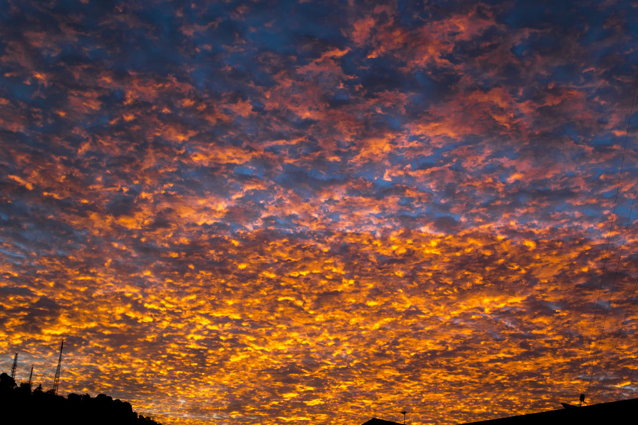 Sunset in the sky with golden clouds Abstract Backdrop Background Cloudscape Colorful Sky Dramatic Sky Dusk Sky Effact Heaven Idylic Landscape Nature Rays Of Light Scenery Sky And Clouds Sunbeam Sunset Sunshine Vivid Weather