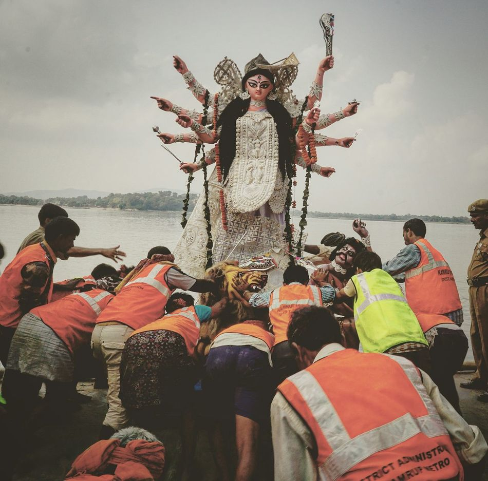 Workers struggling to immerse the idol of Goddess Durga in the river Brahmaputra in Guwahati. Durga Puja is one of the main Hindu festivals celebrated with great enthusiasm and fervor. Hindu Durgapuja India Dailylife Photo Photogrid Festival Goddess Assam Photojournalism Hinduism First Eyeem Photo Enthusiasm Migrant Workers