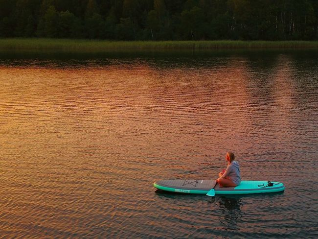 Meditation Water Real People One Person Lake Leisure Activity Nautical Vessel Nature Outdoors Oar Day Women Vacations Lifestyles Standing Paddleboarding Beauty In Nature Kayak Full Length Tree People