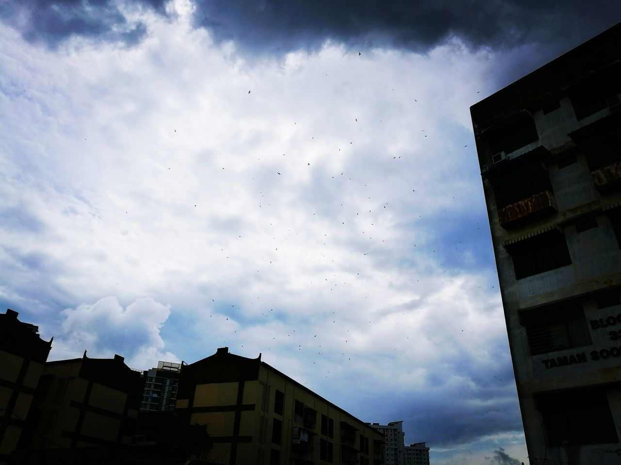 sky, cloud - sky, low angle view, building exterior, architecture, built structure, no people, outdoors, day, city