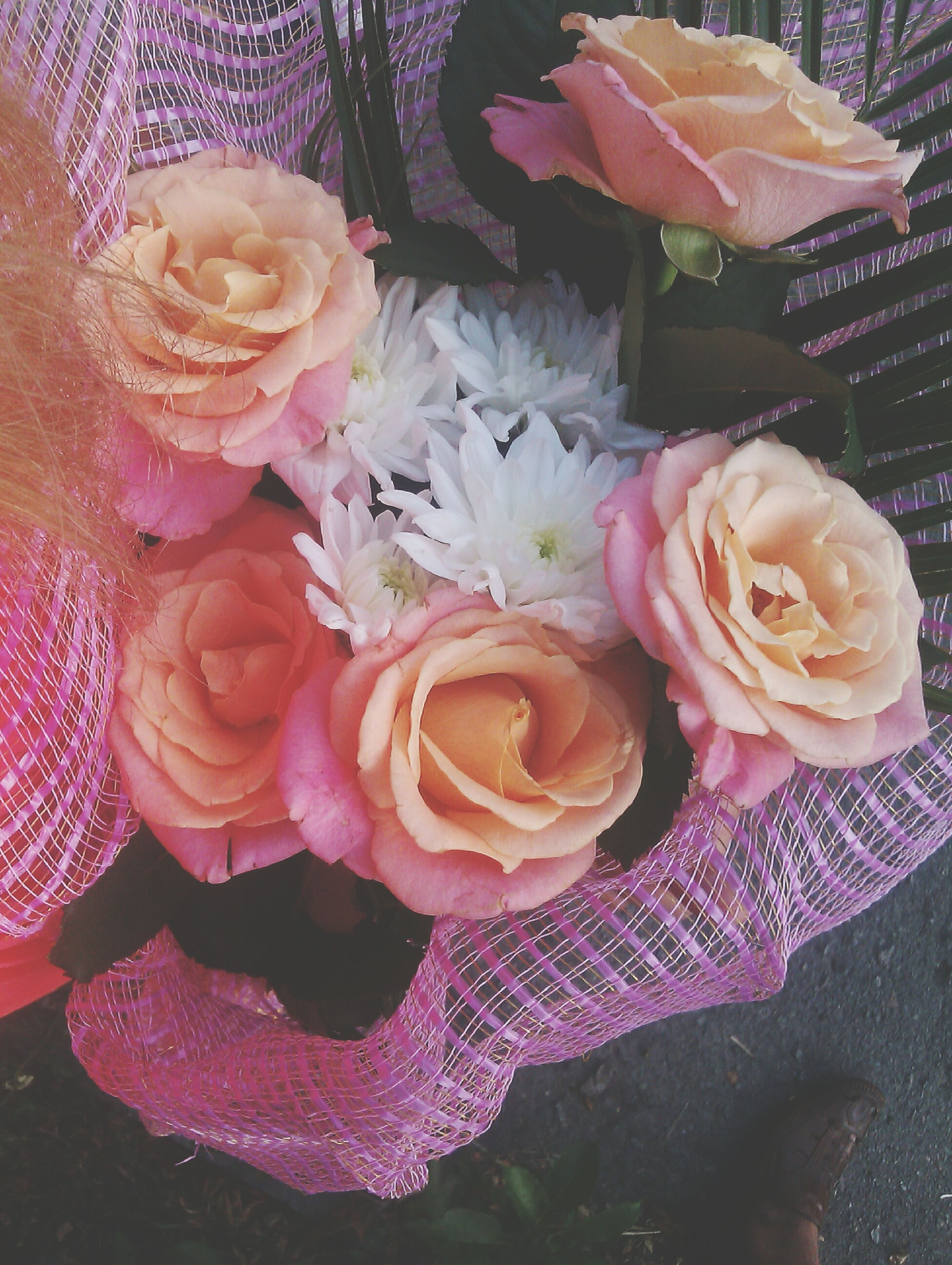 freshness, flower, indoors, rose - flower, sweet food, petal, close-up, dessert, food and drink, high angle view, indulgence, rose, flower head, unhealthy eating, decoration, fragility, table, celebration, bouquet, food