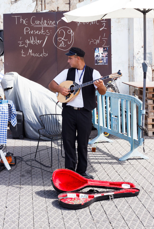 Yafo, Israel, October 15, 2016: Young street musician playing the lute on the waterfront in Yafo, Israel Adult Art Artist Culture Day Entertainment Folk Israel Lute Man Music Musical Musician One Person Outdoors People Performance Person Playing Sea Seaside String Traditional Waterfront Yafo