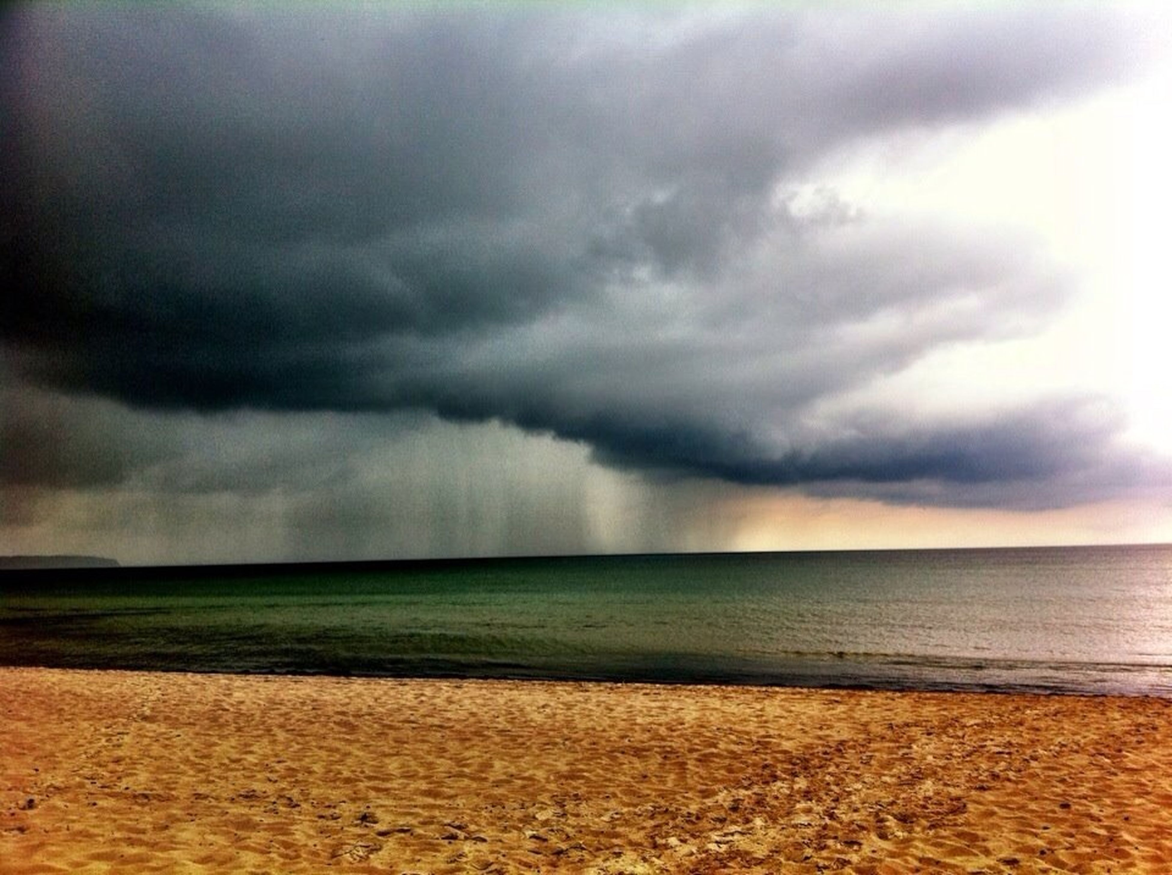 sea, horizon over water, sky, beach, cloud - sky, cloudy, tranquil scene, scenics, water, tranquility, shore, beauty in nature, overcast, sand, weather, nature, cloud, storm cloud, idyllic, remote