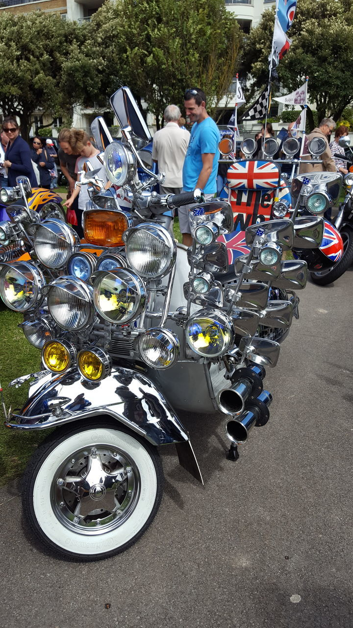 motorcycle, real people, large group of people, biker, day, outdoors, men, transportation, standing, togetherness, lifestyles, tree, sports race, only men, adult, adults only, people