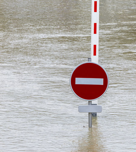 Flood abstract Global Warming Paris Seine Seine River Access Denied Background Circle Disaster Flood Flooding Guidance Interdiction Natural Disaster Outdoors Pillar Red River Road Sign Safety Traffic Sign Traffic Signal Transportation Warning Sign Water Water_collection