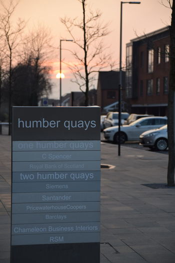 Architecture Barclays Bare Tree Building Exterior Built Structure C Spencer Car City Communication Humber Humber Docks Humber Quays Information Sign Rbs Road Road Sign Royal Bank Of Scotland Santander Siemens  Street Sunset Text Transportation Tree Western Script