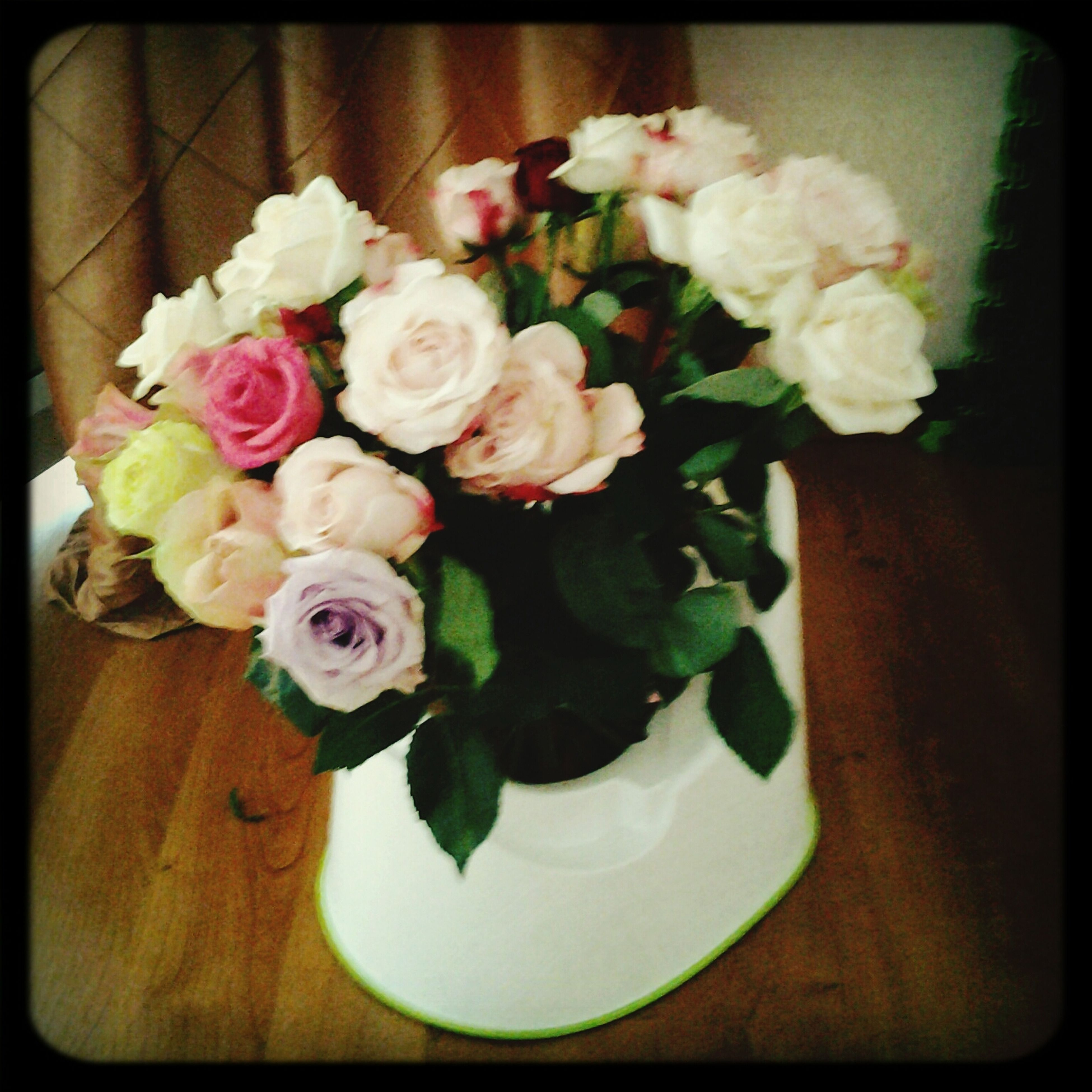flower, freshness, transfer print, indoors, fragility, petal, flower head, vase, rose - flower, bouquet, beauty in nature, bunch of flowers, auto post production filter, flower arrangement, table, close-up, growth, nature, high angle view, rose
