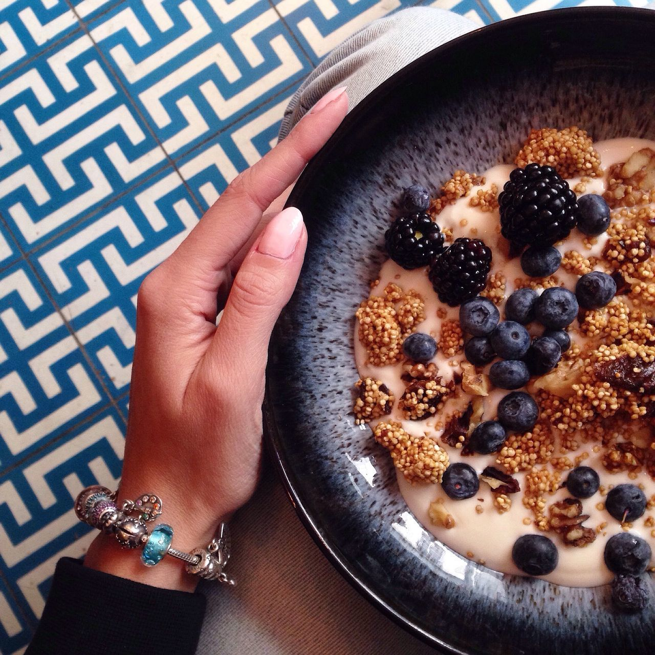 Cropped Image Of Woman Holding Breakfast Bowl At Home