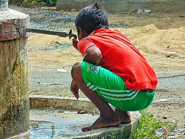 Taking Time To See The Little Things Photo Of The Day Close-up EyeEm Best Shots Portrait Of Innocence Thirsty  Thirst Drinking Water Water Tank Tap Colourful Dress The Photojournalist – 2016 EyeEm Awards The Portraitist - 2016 EyeEm Awards Street Photography The Street Photographer - 2016 EyeEm Awards