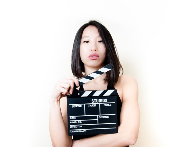Seductive young asian woman with movie clapper board Actress Asian  Asian Girl Audition Beautiful Black Clapper Board Film MOVIE Pretty Studio Shot Woman Young