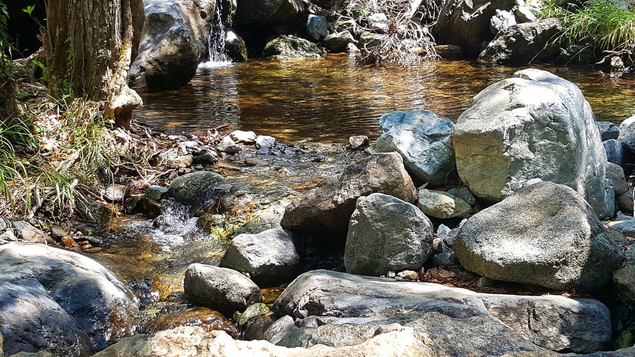 rock - object, water, nature, beauty in nature, rock formation, no people, outdoors, pebble, motion, river, day, waterfall, tranquility