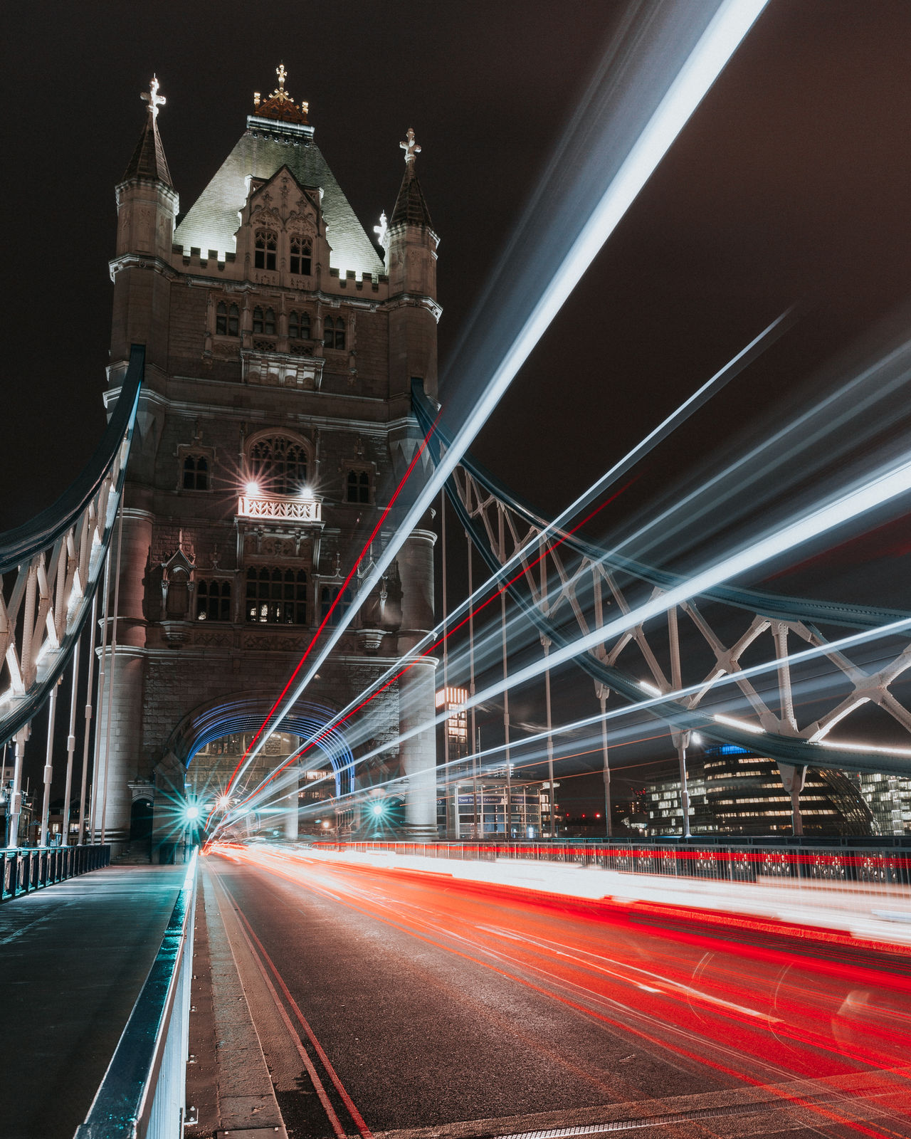 Tower Bridge Architecture Blurred Motion Bridge - Man Made Structure Built Structure Business Finance And Industry City City Life Connection Igniting Illuminated Light Trail Long Exposure Motion Night No People Outdoors Road Sky Speed Suspension Bridge Tower Bridge  Traffic Transportation Travel Travel Destinations