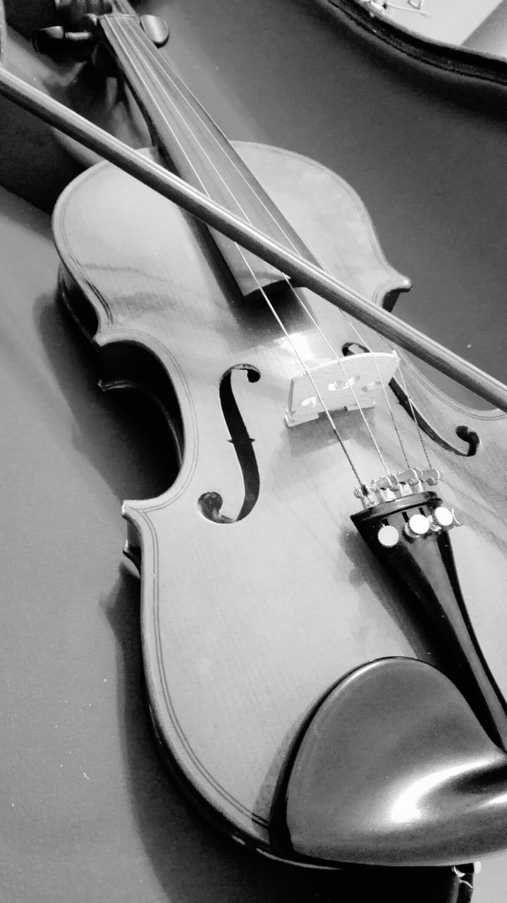 music, musical instrument, musical instrument string, arts culture and entertainment, musical equipment, string instrument, violin, classical music, bow - musical equipment, indoors, high angle view, cello, woodwind instrument, no people, wood - material, close-up, day